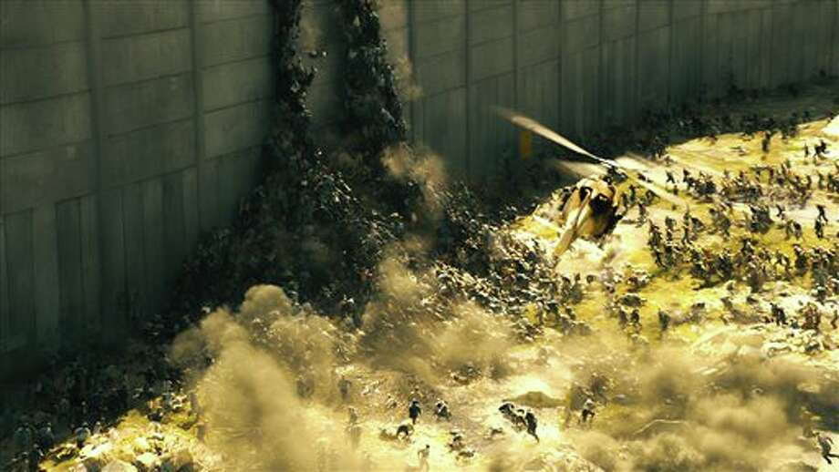 "This publicity image released by Paramount Pictures shows a scene from ""World War Z."" The zombies in ""World War Z"" move with Carl Lewis speed and a swarm-like mentality inspired in part by rabid dogs, furthering the eternal fan debate over whether the walking dead should actually run. (AP Photo/Paramount Pictures) Photo: Uncredited / Paramount Pictures"