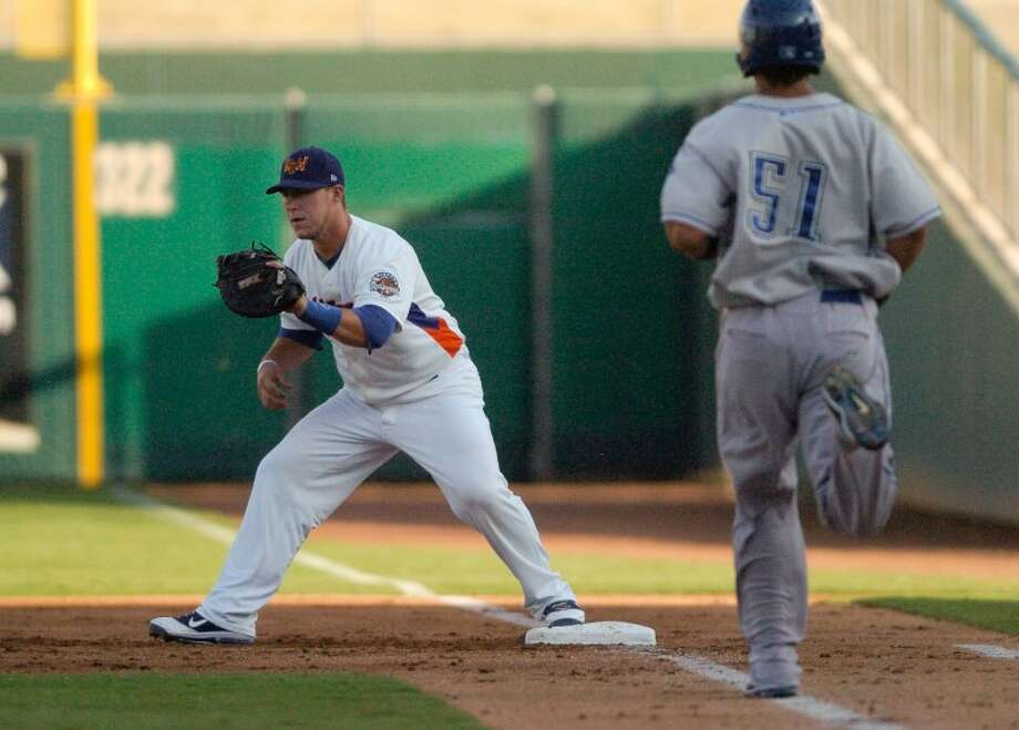 RockHounds first baseman Michael Spina (18) catches the ball to out Tulsa Drillers Branson Sardinha (51) Wednesday during their game at Citibank Ballpark. Cindeka Nealy/Reporter-Telegram Photo: Cindeka Nealy