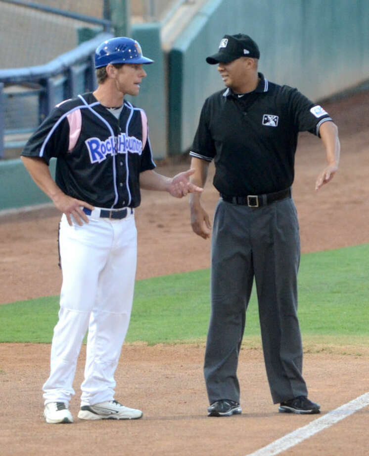 RockHounds Manager Aaron Nieckula discusses a call with third base umpire Will Thornewell during the game against the San Antonio Missions Friday at Citibank Ballpark. James Durbin/Reporter-Telegram Photo: JAMES DURBIN