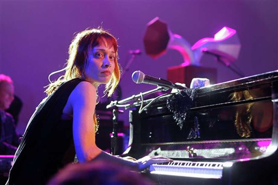 "FILE - This March 14, 2012 file photo shows Fiona Apple performing at the NPR showcase during the SXSW Music Festival in Austin, Texas. Apple has been arrested for hashish possession at a West Texas town after a Border Patrol drug-sniffing dog detected marijuana in her tour bus. Sierra Blanca Sheriff's office spokesman Rusty Flemming says the artist spent Wednesday, Sept. 19, at the Hudspeth County jail and would be bonded out Thursday. Fleming says Apple ""had a little tiny amount of pot and hash."" Fleming says marijuana possession in small amounts is a misdemeanor, while hashish in any quantity is a felony in Texas. (AP Photo/Jack Plunkett, file) Photo: Jack Plunkett / FR59553 AP"