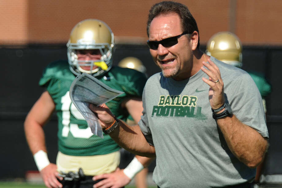 In this photo taken Saturday Aug. 6, 2011, new Baylor defensive coordinator Phil Bennett, right, explains a play during NCAA college football practice in Waco, Texas. Behind Bennett is linebacker Brody Trahan, left.( AP Photo/Waco Tribune Herald, Rod Aydelotte) Photo: Rod Aydelotte / Waco Tribune Herald