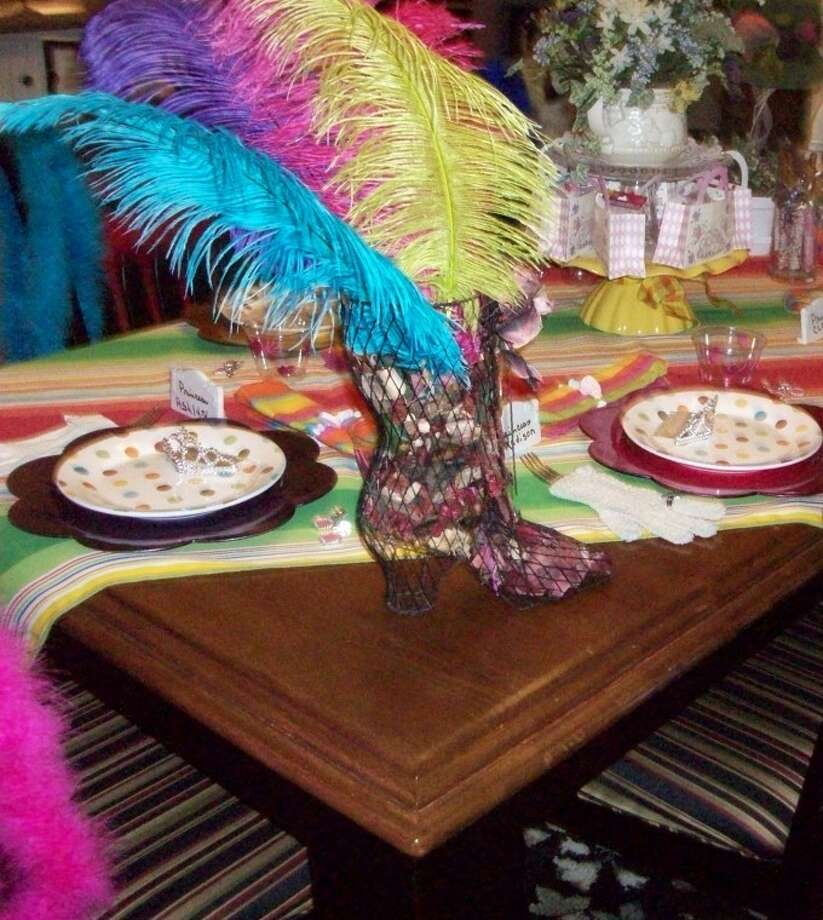 Colorful feathers and table settings provide decor for a tea party for young girls. Photo: Courtesy Photo
