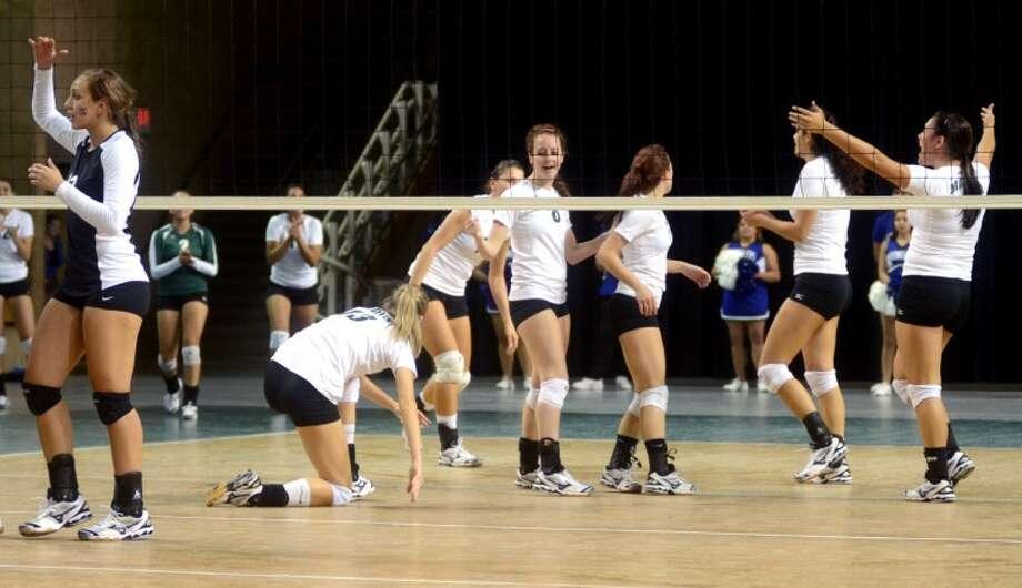 The Midland College girls volleyball team celebrates after winning against Odessa Wednesday at the Chaparral Center. Midland beat Odessa 3-1. James Durbin/Reporter-Telegram Photo: JAMES DURBIN