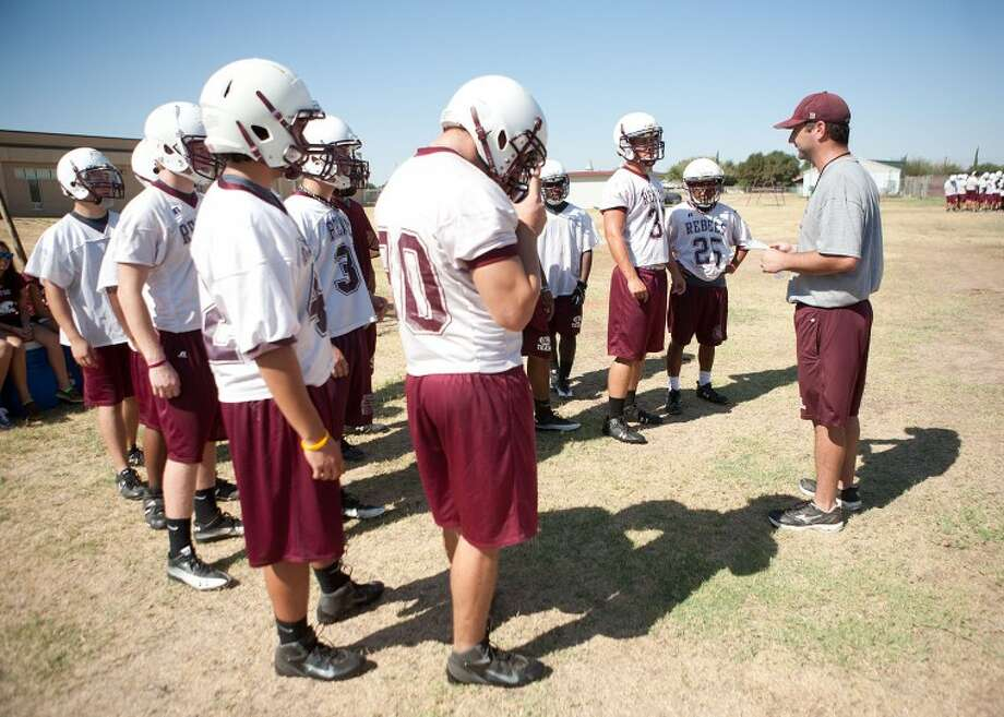 Asst. Coach Jarred Morris talks to the running backs during practice on Aug. 8 at Lee High School. Cindeka Nealy/Reporter-Telegram Photo: Cindeka Nealy