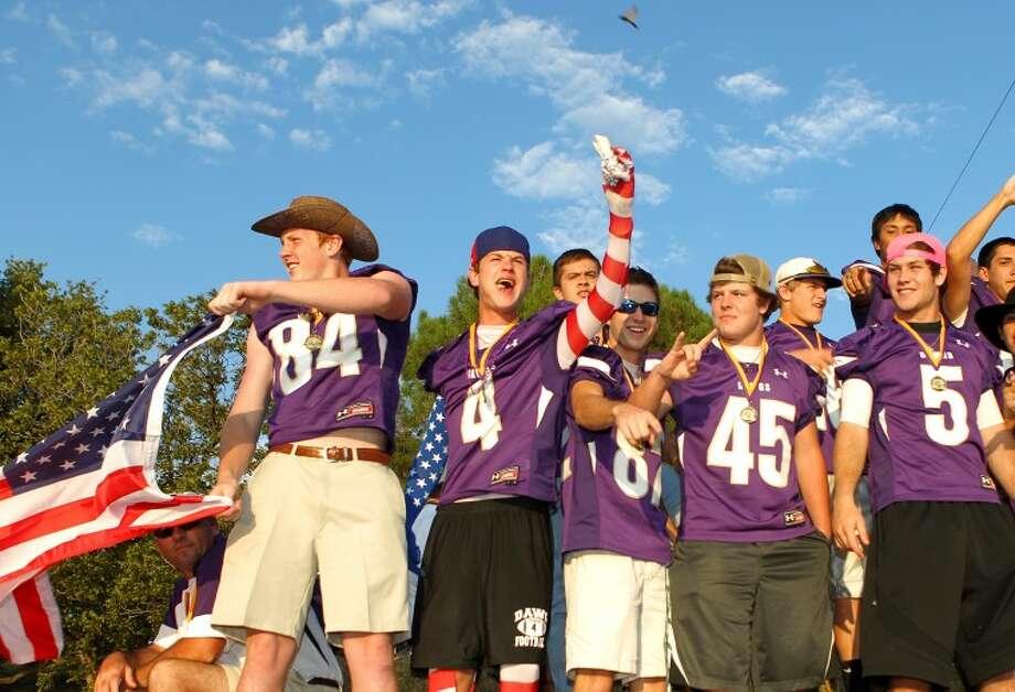 The Midland High School football team on their float during the MHS Homecoming Parade Thursday. James Durbin/Reporter-Telegram Photo: JAMES DURBIN