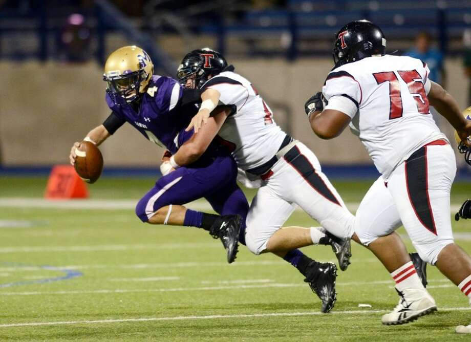 Midland quarterback Connor Beck is brought down by the Amarillo Tascosa defense in the first half of play Friday at Grande Stadium. James Durbin/Reporter-Telegram Photo: JAMES DURBIN