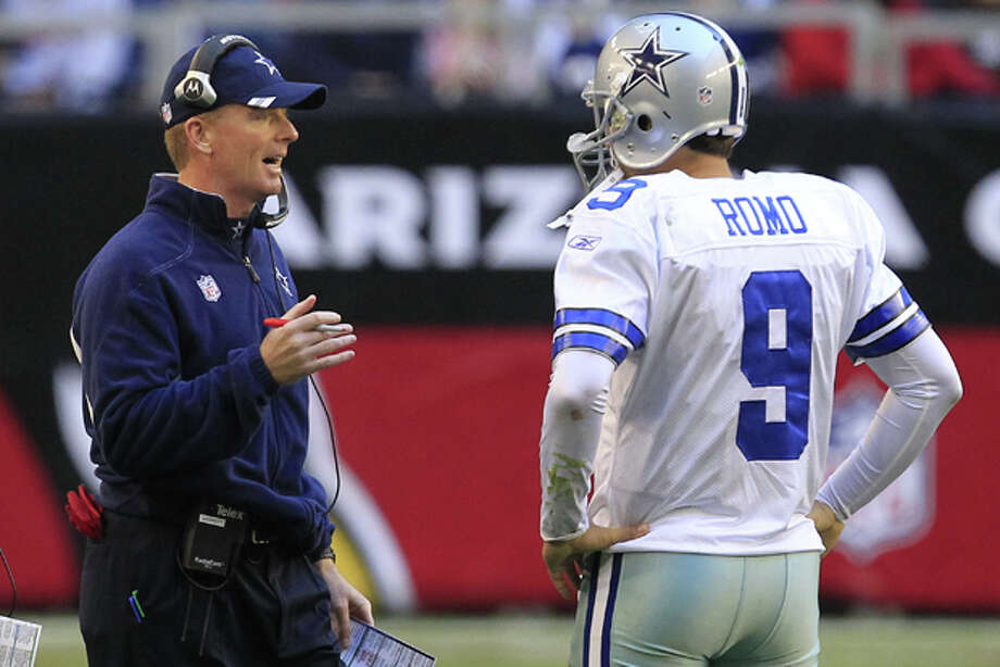 Dallas Cowboys head coach Jason Garrett, left, talks with quarterback Tony Romo (9) during an NFL football game against the Arizona Cardinals Sunday, Dec. 4, 2011, in Glendale, Ariz. The Cardinals defeated the Cowboys in overtime 19-13. (AP Photo/Ross D. Franklin) Photo: Ross D. Franklin / AP