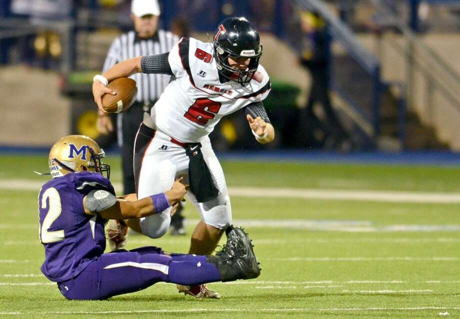 Midland linebacker Marcus Salinas wraps up Amarillo Tascosa quarterback Tucker Davidson in the first half of play Friday at Grande Stadium. James Durbin/Reporter-Telegram Photo: JAMES DURBIN