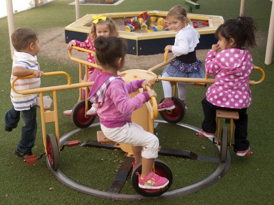 Students at Helen L. Greathouse Children's Learning Center at Midland College play on the playground Tuesday morning. Tim Fischer/Reporter-Telegram Photo: Tim Fischer