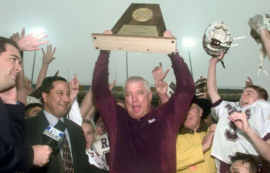 Former Lee coach John Parchman holds up one the three state championship trophies his Rebels won during his time at the school. There is something to be said for the fact that Parchman had a future NFL running back and offensive linemen on those teams, but those squads also had athletes at other positions as well. What Parchman did was convince all of them that the winning as a team was more important than anything they could've done as individuals. Parchman was 88-24-1 during his nine years at Lee and was 43-3 during the three-year state title run. Photo: MRT Archives