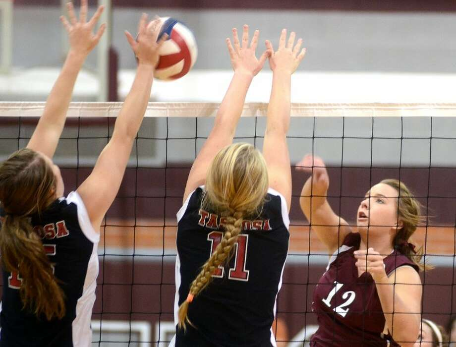 Lee High outside hitter Jenn Jeter attempts to hit against Amarillo Tascosa Saturday at Lee. James Durbin/Reporter-Telegram Photo: JAMES DURBIN