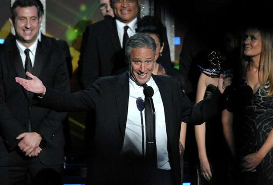 "Jon Stewart accepts the award for Outstanding Variety Series for ""The Daily Show with Jon Stewart"" at the 64th Primetime Emmy Awards at the Nokia Theatre on Sunday, Sept. 23, 2012, in Los Angeles. (Photo by John Shearer/Invision/AP) Photo: John Shearer / Invision"
