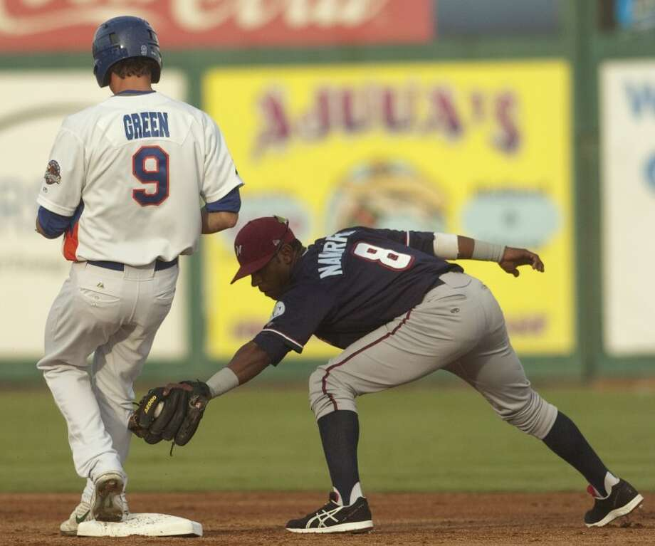 RockHounds' Grant Green stops for a stand upo double as Arkansas Naturals' Rey Navarro is too late to make the tag Saturday at CitiBank Ballpark. Photo by Tim Fischer/Midland Reporter-Telegram Photo: Tim Fischer