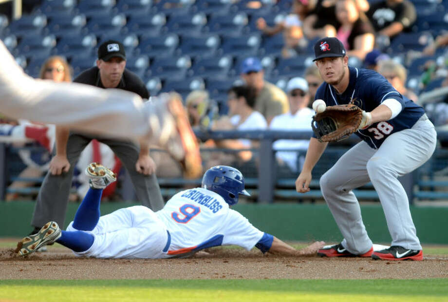 RockHounds Conner Crumbliss slides back into first base as Arkansas Travelers' C.J. Cron tries to pick him off Saturday at Citibank Ballpark. James Durbin/Reporter-Telegram Photo: JAMES DURBIN