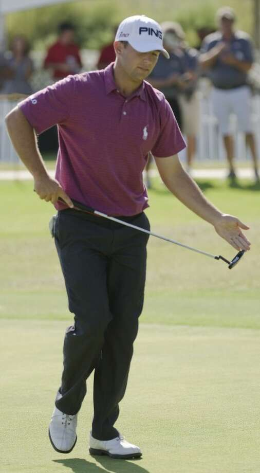 Luke Guthrie patts his putter after making parr on the 18th hole to keep him at -6 for the round. Tim Fischer/Reporter-Telegram Photo: Tim Fischer