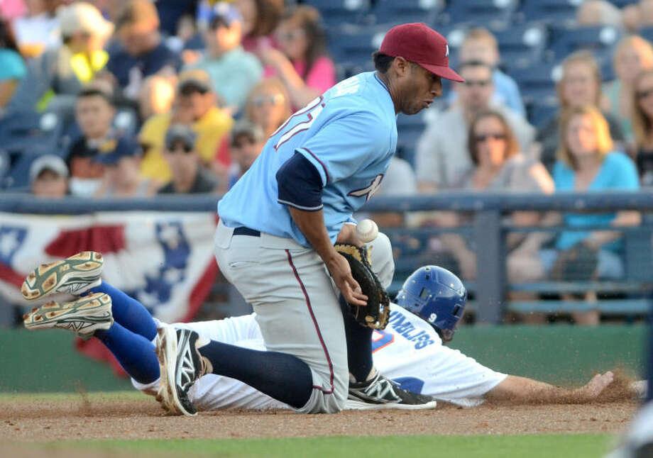 RockHounds' Conner Crumbliss beats a pickoff attempt by Northwest Arkansas first baseman Matt Fields Friday at Citibank Ballpark. James Durbin/Reporter-Telegram Photo: JAMES DURBIN