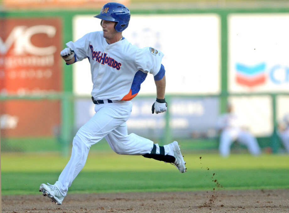 RockHounds' Jake Goebbert rounds the bases after hitting a triple against Northwest Arkansas Friday at Citibank Ballpark. James Durbin/Reporter-Telegram Photo: JAMES DURBIN