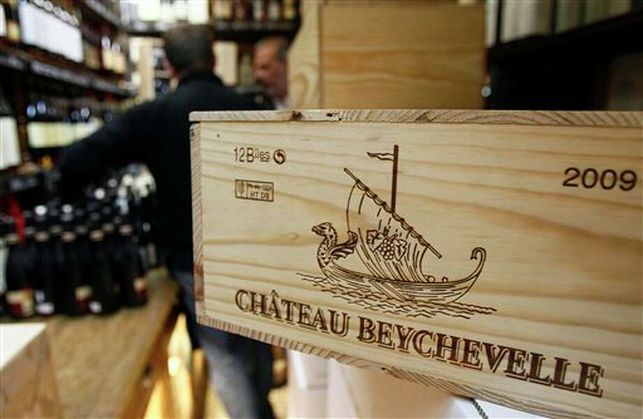 This Sept. 20, 2012, photo shows a 12-bottle wooden box of Bordeaux wine Chateau Beychevelle in a wine shop in Paris. The United States wants to sell some of their wines in the European Union with a ''chateau'' label. Next week, EU experts will look whether it should permitted with a fight among member states set for later this year, well after the wine harvest. (AP Photo/Remy de la Mauviniere) Photo: Remy De La Mauviniere / AP