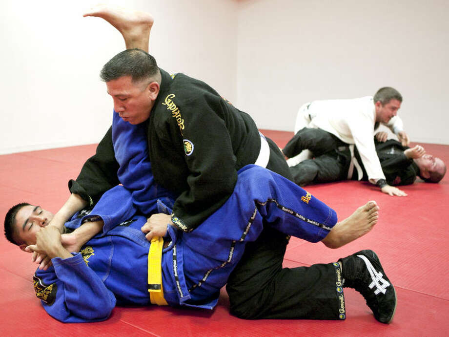 Chris Fuentes and Miguel Ramos spar Thursday at Perez Martial Arts Academy. Fuentes and Ramos recently won third place in Brazilian Jiu Jitsu at the Texas Police Olympics. James Durbin/Reporter-Telegram Photo: JAMES DURBIN