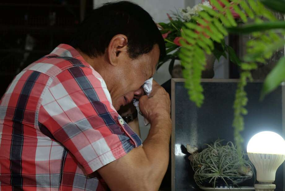 Rodrigo Duterte wipes his tears at the tomb of his late father in Davao city. He has threatened to form one-man rule if legislators in Congress oppose him. Photo: Kiwi Bulaclac, Associated Press