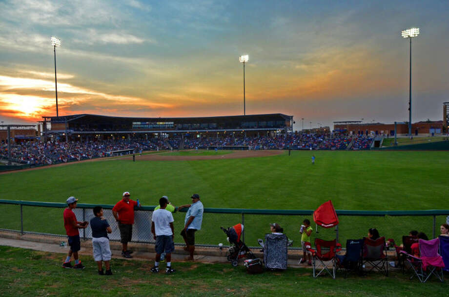 RockHounds fans watch from a hill behind center field during the game against Northwest Arkansas Wednesday at Citibank Ballpark. James Durbin/Reporter-Telegram Photo: JAMES DURBIN