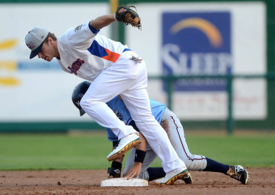 RockHounds' Dusty Coleman tries to tag out Northwest Arkansas' Whit Merrifield at second base Wednesday at Citibank Ballpark. James Durbin/Reporter-Telegram Photo: JAMES DURBIN