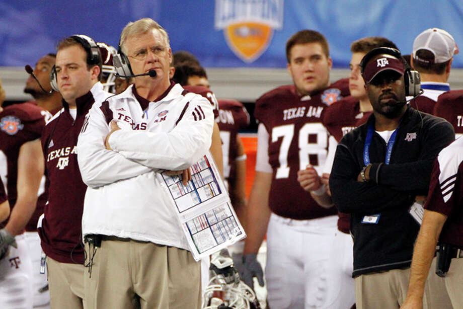 FILE - In this Jan. 7, 2011 file photo, Texas A&M head coach Mike Sherman, left looks on from the sideline during the second half of the Cotton Bowl NCAA college football game against LSU in Arlington, Texas. Texas A&M considered a move to the Southeastern Conference last year before deciding to stay in the Big 12. Now many are wondering if the Aggies' days in the Big 12 are numbered, and what that could mean for the future of the conference. (AP Photo/Tony Gutierrez, File) Photo: Tony Gutierrez / AP2011