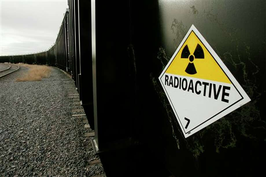 "File - This Feb. 8, 2007, file photo, shows a warning sign attached to rail cars containing low-level radioactive waste ready for processing at the EnergySolutions facility, in Clive, Utah. State regulators should stop relying solely on the honor system in its monitoring of companies bringing low-level radioactive waste into the state, according to a legislative audit. The auditors say that without independent oversight, it's impossible to know whether the privately owned EnergySolutions disposal site in Tooele County is burying illegal waste, The Salt Lake Tribune reported. The company says its processes are safe and claims it was ""targeted"" by auditors, noting the findings were based on ""fundamentally flawed assumptions."" (AP Photo/Douglas C. Pizac, File) Photo: Douglas C. Pizac / AP"