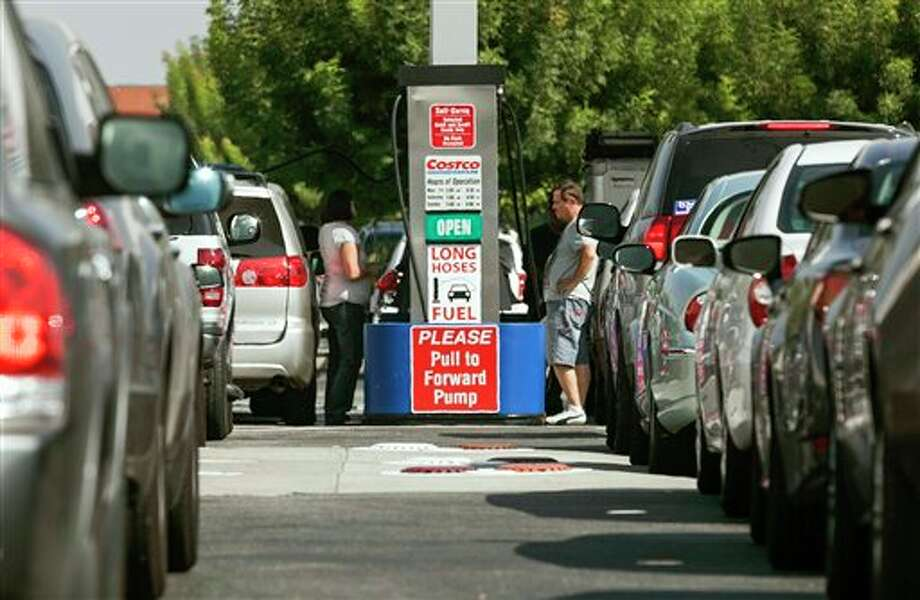 (File Photo) Costco members fill up with discounted gasoline at a Costco gas station in Van Nuys, Calif., Friday, Oct. 5, 2012. Californians woke up to a shock Friday as overnight gasoline prices jumped by as much as 20 cents a gallon in some areas, ending a week of soaring costs that saw some stations close and others charge record prices. (AP Photo/Damian Dovarganes) Photo: Damian Dovarganes / AP