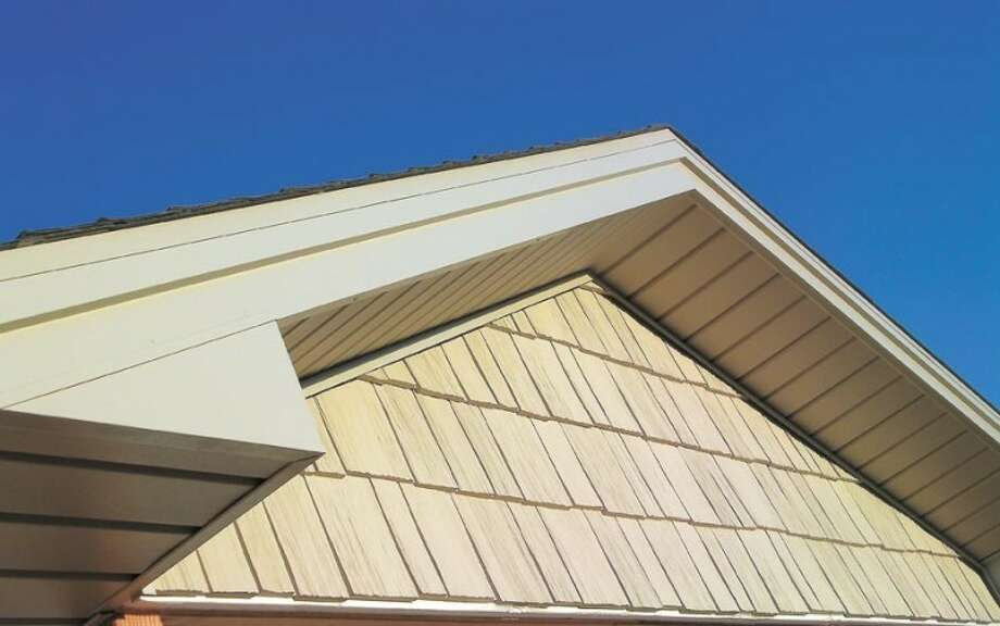 Everything is beautiful—your home's exterior and your heating and cooling bills when you let American Home Improvement install insulated siding. And you'll probably never have to paint again. Call American Home Improvement at 550-7224 for a free estimate.