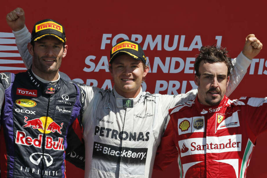 Mercedes driver Nico Rosberg of Germany, centre, celebrates after winning the Formula One British Grand Prix at the Silverstone circuit, Silverstone, England, Sunday, June 30, 2013. Red Bull driver Mark Webber of Australia, left, finished second and Ferrari driver Fernando Alonso of Spain, right, finished third. (AP Photo/Lefteris Pitarakis) Photo: Lefteris Pitarakis