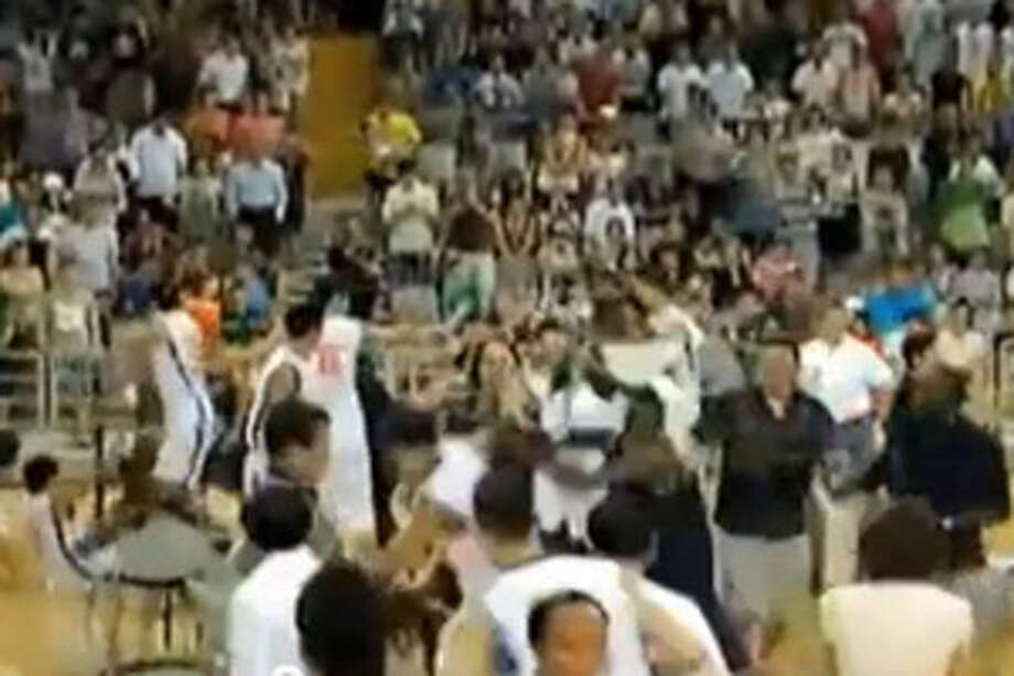 "Players from Georgetown University and Team China brawl during a ""goodwill"" basketball game."