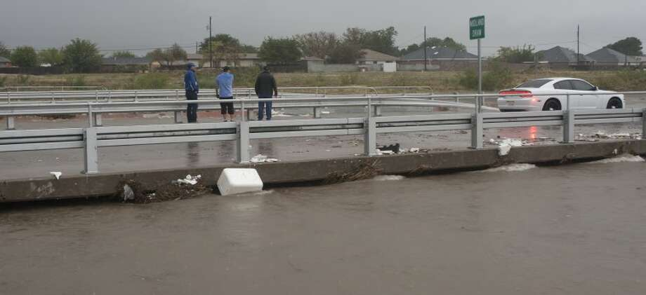 City crews check the bridge over Midalnd Draw on Scharbauer Drive Friday morining. Units blocked Scharbauer Drive between Lamesa and Butternut Lane after the Scharbauer Draw and Midland Draw overflowed their banks and flooded the street. Tim Fischer\Reporter-Telegram Photo: Tim Fischer