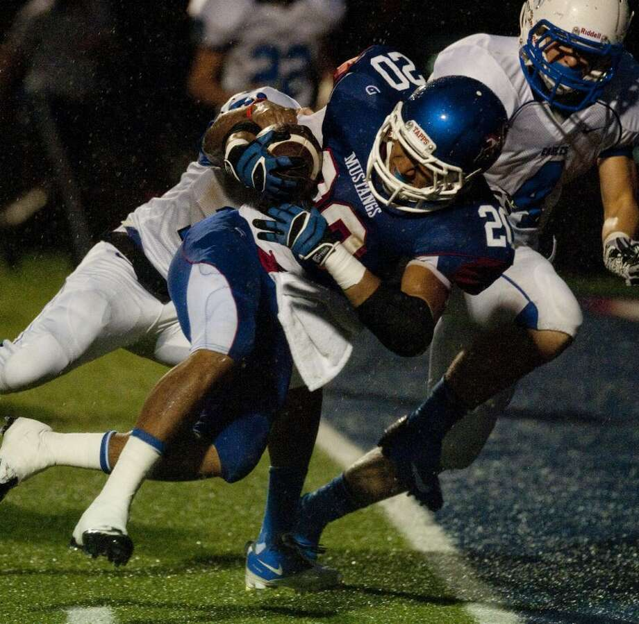 Midland Christian's Christian Whigham powers into the end zone dragging Southwest Christian's Corbin Thomas-McQuay Friday night at Mustang Field. Tim Fischer\Reporter-Telegram Photo: Tim Fischer