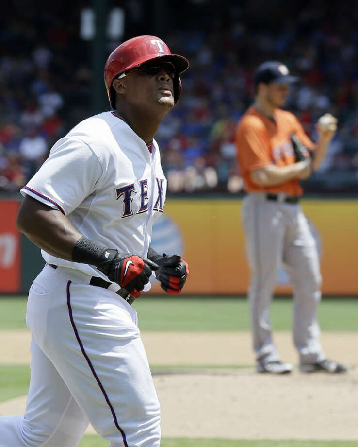 Texas Rangers' Adrian Beltre looks to the stands as he runs home following his solo home run off Houston Astros starting pitcher Erik Bedard, background, in the third inning of a baseball game on Sunday in Arlington. (AP Photo/Tony Gutierrez) Photo: Tony Gutierrez
