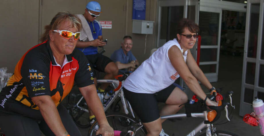 Midlanders Tammy Lorenz, left, Von Doria, left center, and Danette Beals, right, spin their gears while raising money and awareness for Multiple Schlerosis Sunday outside of Sam's Club in Midland. Tyler White/Reporter-Telegram Photo: Tyler White