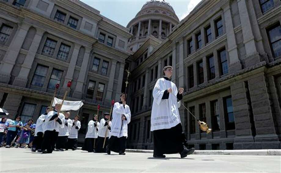 Anti-abortion supporters take part in a rosary procession around the Texas Capitol as the Texas House debates HB 2, a bill that will place restrictions on abortion in the state, Tuesday, July 9, 2013, in Austin, Texas. (AP Photo/Eric Gay) Photo: Eric Gay / AP