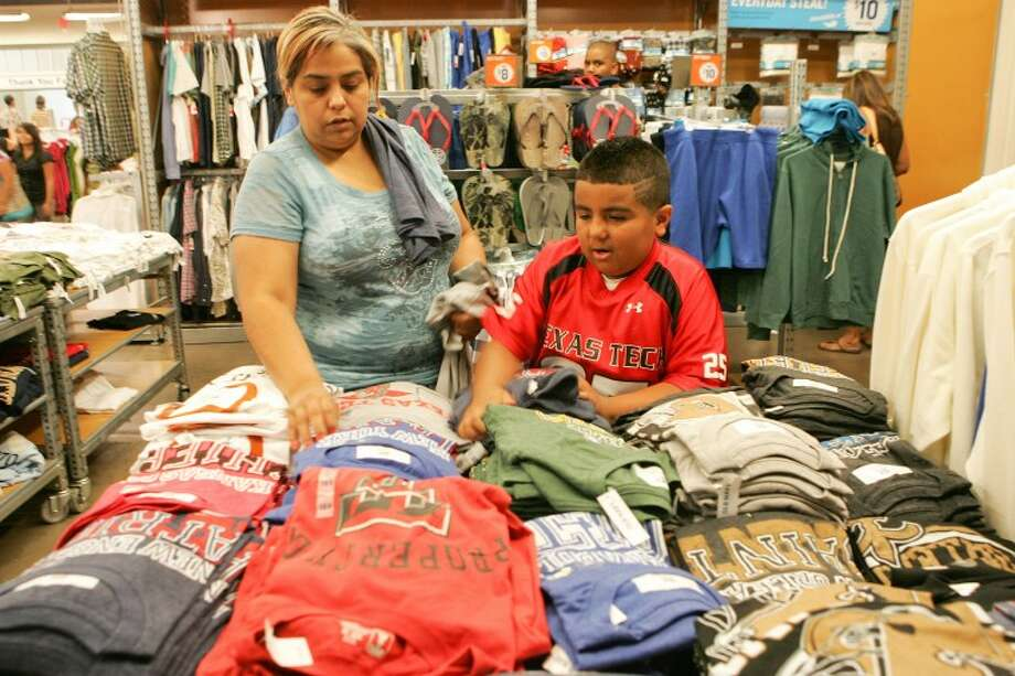 Monica Reyes and her son Jordan, 9, work at finishing their school shopping during tax free weekend Saturday at Old Navy in the Midland Park Mall. Cindeka Nealy/Reporter-Telegram Photo: Cindeka Nealy