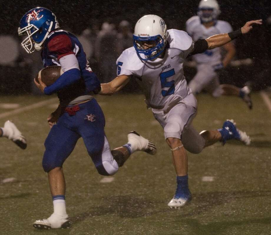 Midland Christian's Elias Aguirre gets by Southwest Christian's Justin Wyatt on his way to a touchdown Friday night at Mustang Field. Tim Fischer\Reporter-Telegram Photo: Tim Fischer