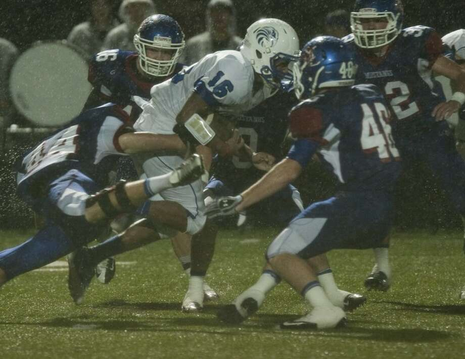Southwest Christian's Corbin Thomas-McQuay gets stopped by half the Midland Christian defense earlier this season at Mustang Field. Tim Fischer\Reporter-Telegram Photo: Tim Fischer
