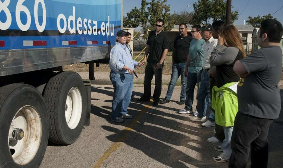Odessa College CDL driving instructor Julie Bridges talks with her class Tuesday as they practice a walk around a truck to check it out during class at OC. Tim Fischer\Reporter-Telegram Photo: Tim Fischer