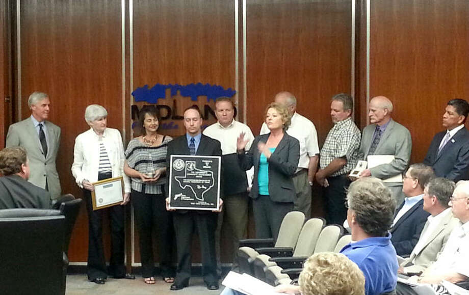 Keep Midland Beautiful volunteers are presented with the Governor's Community Achievement Award and recognized for being a Gold Star Affiliate at Tuesday's City Council meeting. From left: Mayor Wes Perry, Sharla Hotchkiss, Cindy Martin Jeffrey Ahrlett, Bob Murphy, Doreen Womack, Bart Hotchkiss, Johnny Womack, Gary Saunders and Councilman Jerry Morales.