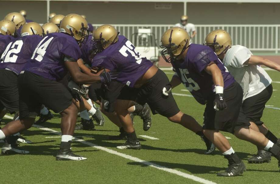 Midland High players run drills Monday during practice. Photo by Tim Fischer/Midland Reporter-Telegram Photo: Tim Fischer