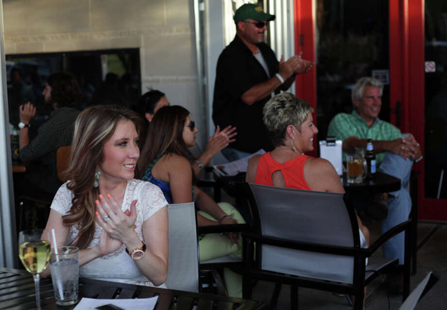 Patio diners at Basin Burger House listen to 3OG's perform. Photo: MARY POWERS