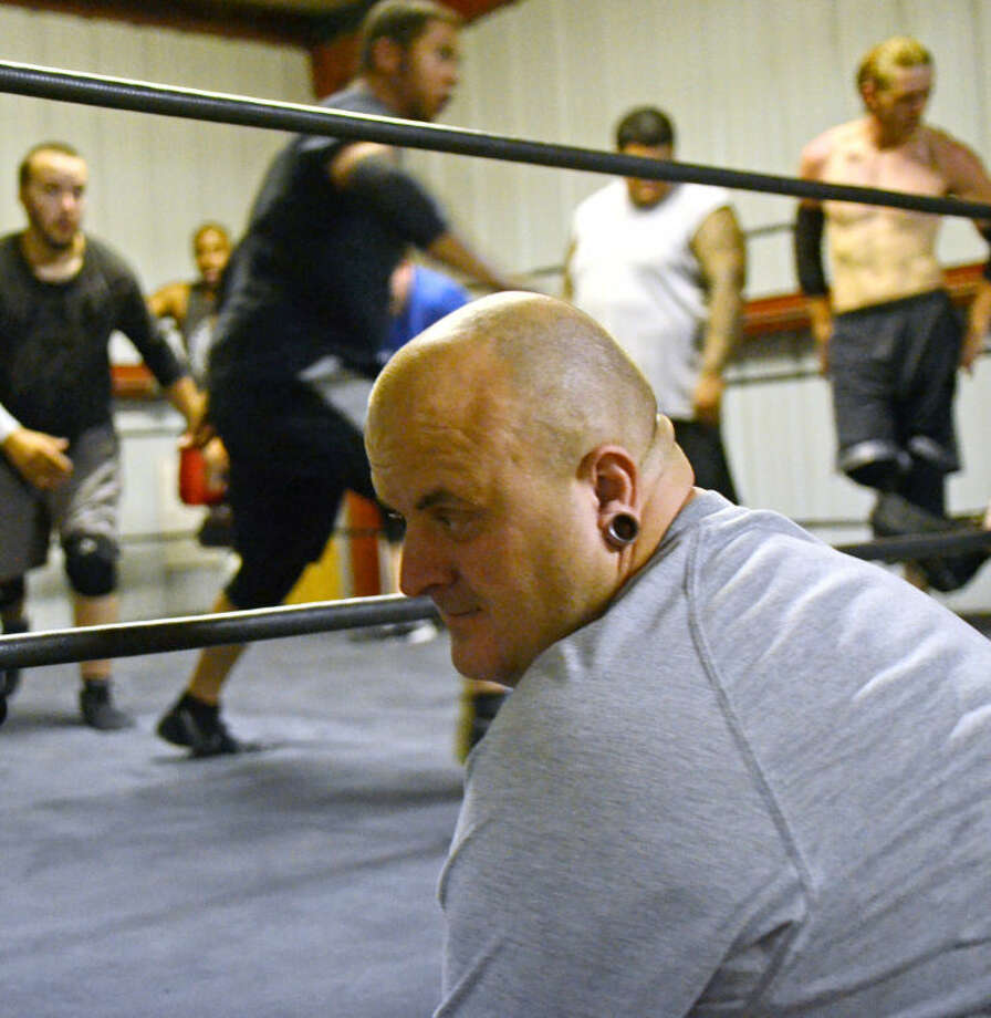 Old School Wrestling owner Fred Urban looks on Tuesday at the Old School Wrestling facility in Odessa. James Durbin/Reporter-Telegram