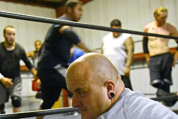 Old School Wrestling owner Fred Urban looks on Tuesday at the Old School Wrestling facility in Odessa. James Durbin/Reporter-Telegram