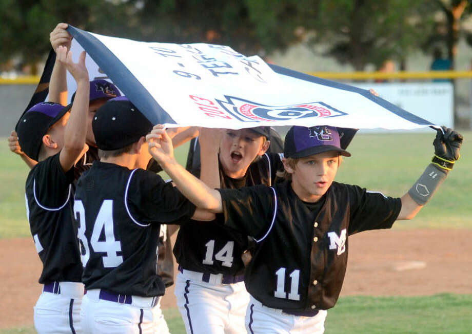 The Mid City Little League (ages 9-10) team celebrates after winning the sectional final against Monahans Thursday at Butler Park. James Durbin/Reporter-Telegram Photo: JAMES DURBIN