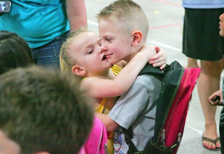 Makayla Perry, 3, gives her brother Mark, 5, a kiss on the cheek before he heads to his kindergarten classroom to begin his first day of school at Sam Houston Elementary. Cindeka Nealy/Reporter-Telegram Photo: Cindeka Nealy