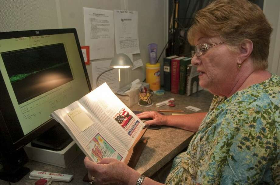 Carolyn Larson, long time volunteer, reads an article from Texas Monthly as part of her duties at Recording Library of West Texas. Photo by Tim Fischer/Midland Reporter-Telegram Photo: Tim Fischer