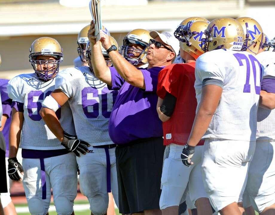 Midland High offensive linemen run practice drills Wednesday at Memorial Stadium. James Durbin/Reporter-Telegram Photo: JAMES DURBIN